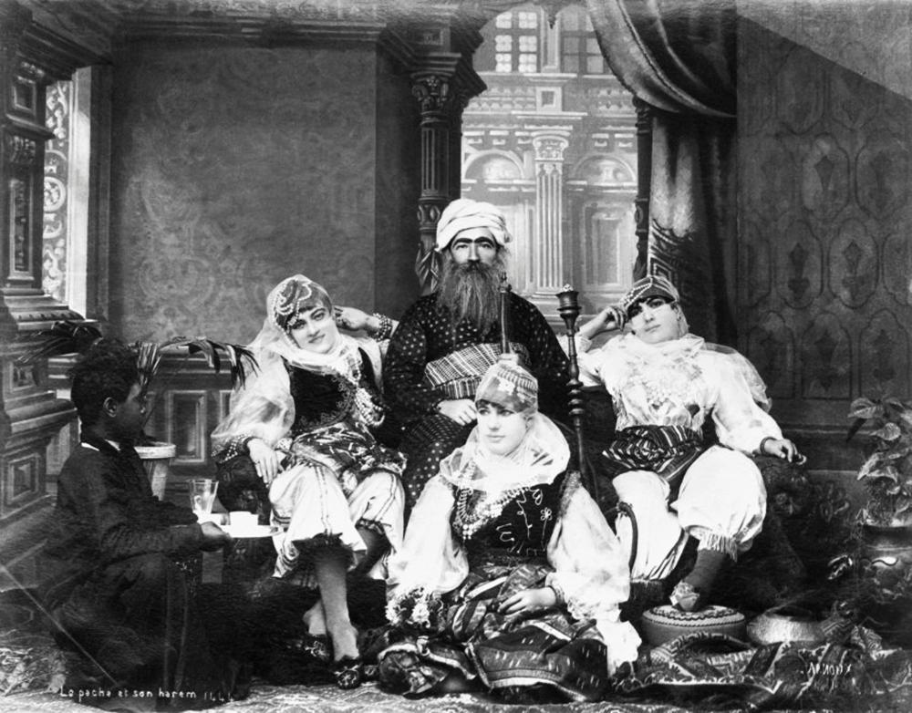 https://www.thecannachronicles.com/wp-content/uploads/2019/05/pasha-and-harem-port-said-egypt-1885-1.jpg